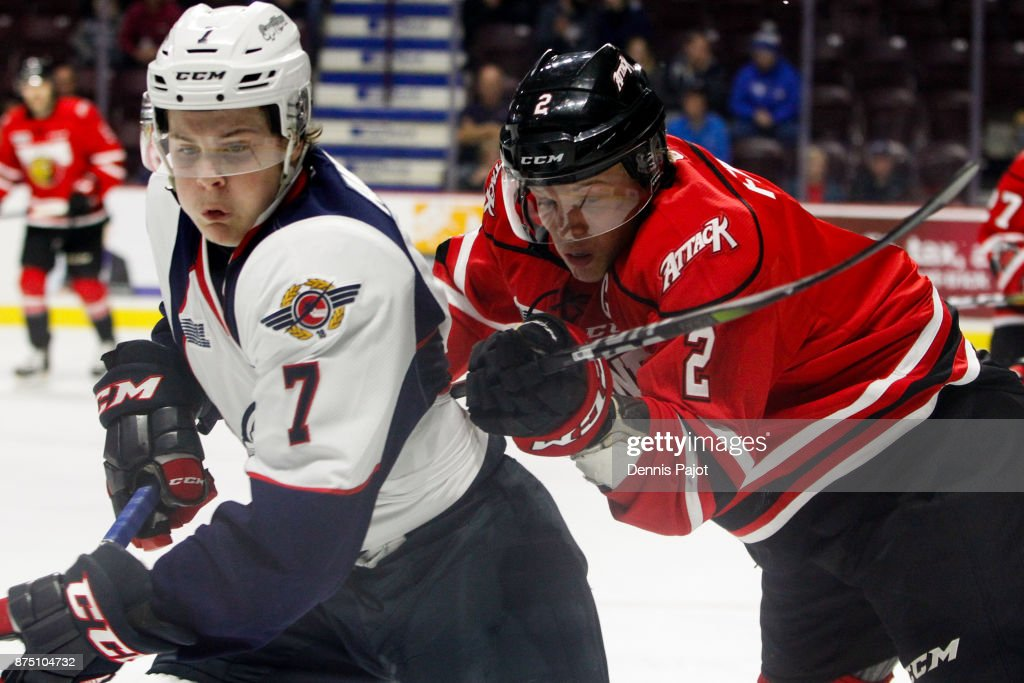 Defenceman Jacob Friend #2 of the Owen Sound Attack battles against forward Tyler Angle #7 of the Windsor Spitfires on November 16, 2017 at the WFCU Centre in Windsor, Ontario, Canada.