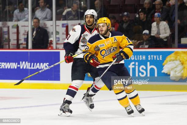 Defenceman Jalen Chatfield of the Windsor Spitfires skates against forward Alex DeBrincat of the Erie Otters on May 24 2017 during Game 6 of the...