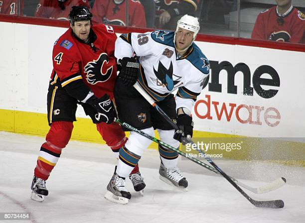 Defenceman Jim Vandermeer of the Calgary Flames keeps watch on Ryane Clowe of the San Jose Sharks during game four of the Western Conference...