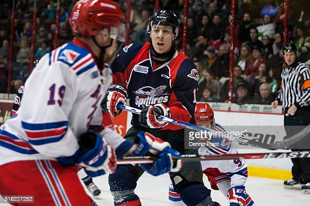 Defenceman Logan Stanley of the Windsor Spitfires battles for the puck against the Kitchener Rangers on March 17 2016 at the WFCU Centre in Windsor...