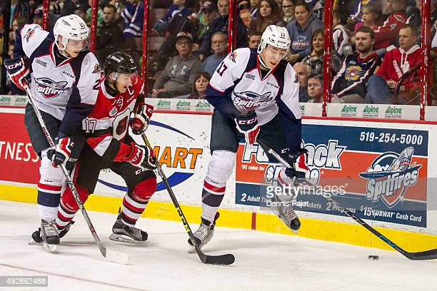 Defenceman Logan Stanley of the Windsor Spitfires moves the puck against forward Travis Konecny of the Ottawa 67's on October 15 2015 at the WFCU...