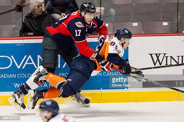 Defenceman Logan Stanley of the Windsor Spitfires places a huge hit against forward Dane Johnstone of the Flint Firebirds on January 21 2016 at the...
