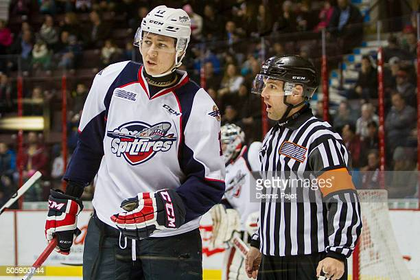 Defenceman Logan Stanley of the Windsor Spitfires speaks with referee Shawn Hamlinon in a game against the Sarnia Sting on December 28 2015 at the...