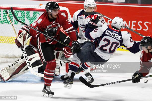 Defenceman Mark Shoemaker of the Guelph Storm places a hit against Luke Kutkevicius of the Windsor Spitfires on September 24 2017 at the WFCU Centre...