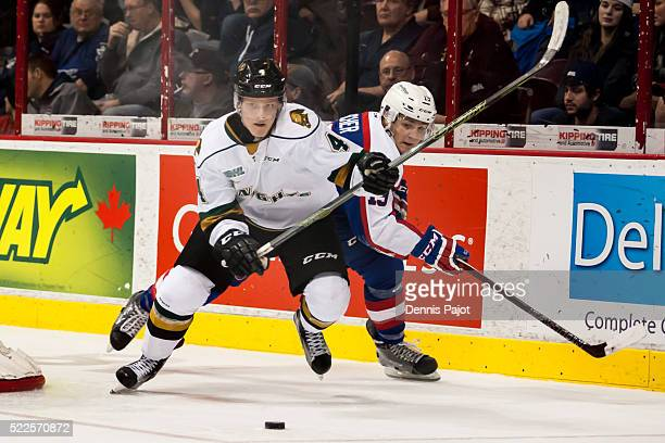 Defenceman Olli Juolevi of the London Knights moves the puck against forward Christian Fischer of the Windsor Spitfires on January 30 2016 at the...