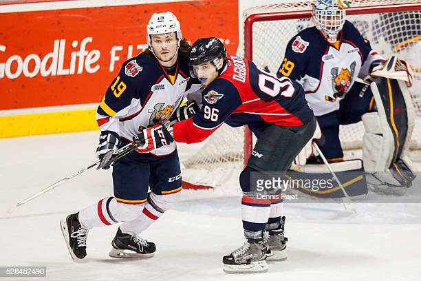 Defenceman Rasmus Andersson of the Barrie Colts battles against forward Cristiano DiGiacinto of the Windsor Spitfires on February 25 2016 at the WFCU...