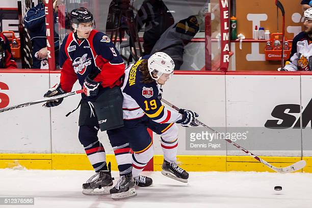 Defenceman Rasmus Andersson of the Barrie Colts moves the puck against forward Christian Fischer of the Windsor Spitfires on February 25 2016 at the...