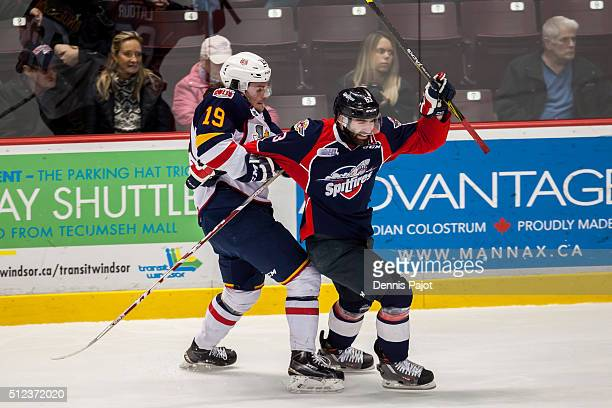 Defenceman Rasmus Andersson of the Barrie Colts ties up forward Bradley Latour of the Windsor Spitfires on February 25 2016 at the WFCU Centre in...