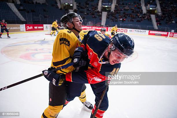 Defenceman Santeri Lukka of Kalpa tackles Defenceman David Bernhardt of Djurgarden during the Champions Hockey League Round of 32 match between...