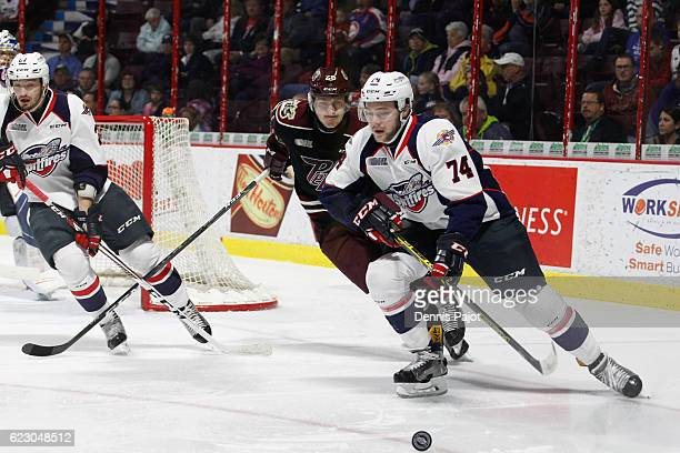 Defenceman Sean Day of the Windsor Spitfires moves the puck against forward Josh Coyle of the Peterborough Petes on November 13 2016 at the WFCU...