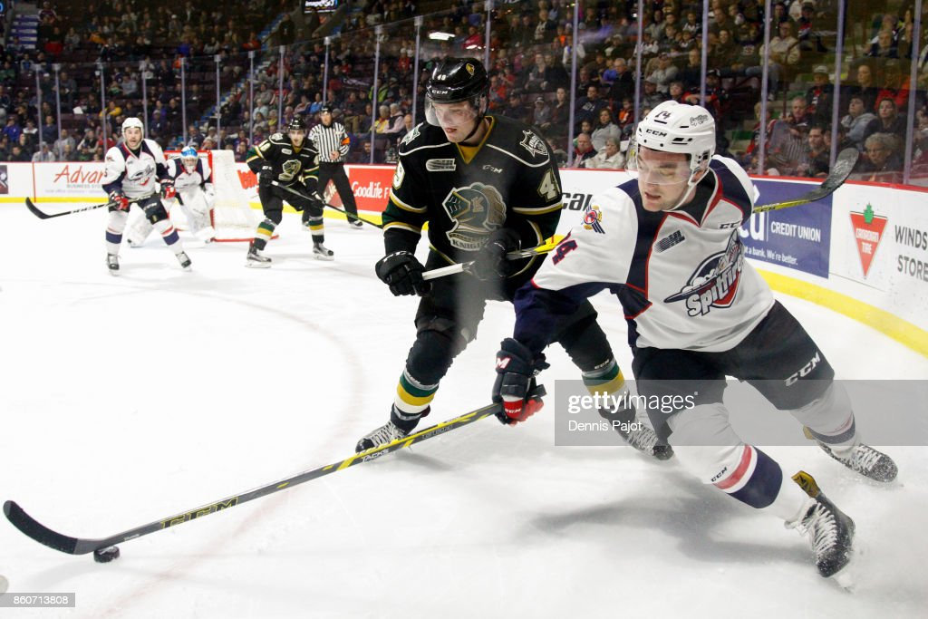 Defenceman Sean Day #74 of the Windsor Spitfires moves the puck against forward Max Jones #49 of the London Knights on October 12, 2017 at the WFCU Centre in Windsor, Ontario, Canada.
