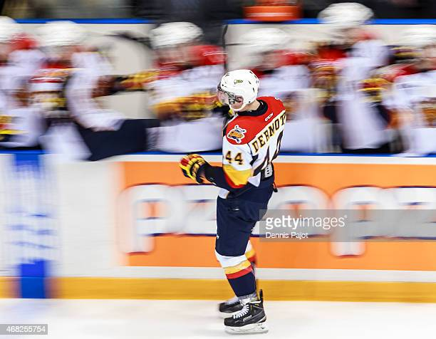 Defenceman Travis Dermott of the Erie Otters celebrates a goal against the Sarnia Sting during Game Four of the Western Conference QuarterFinals on...