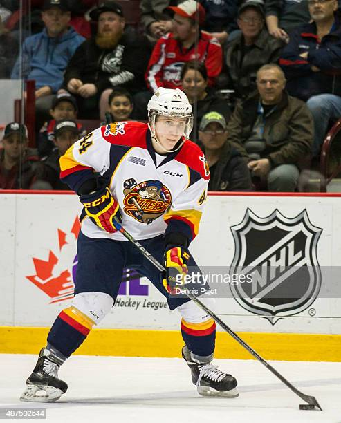 Defenceman Travis Dermott of the Erie Otters moves the puck against the Windsor Spitfires on March 19 2015 at the WFCU Centre in Windsor Ontario...