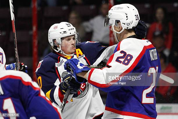 Defenceman Tyler Nother of the Windsor Spitfires battles in front of the net against Defenceman Justin Murray of the Barrie Colts on November 6 2016...