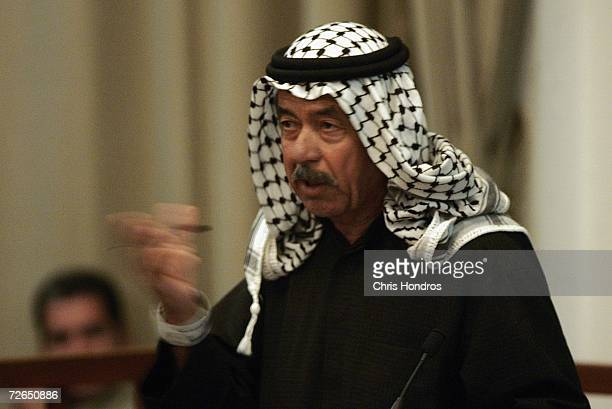 Defendant Ali Hassan alMajid makes a point to the court during the continuation of the 'Anfal' genocide trial on November 27 2006 in Baghdad Iraq The...