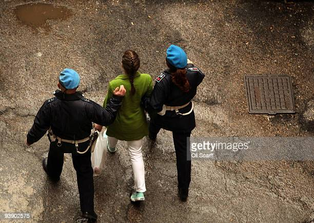 Defendant Amanda Knox is escorted away from court at the end of the final day of the Meredith Kercher murder trial on December 4 2009 in Perugia...