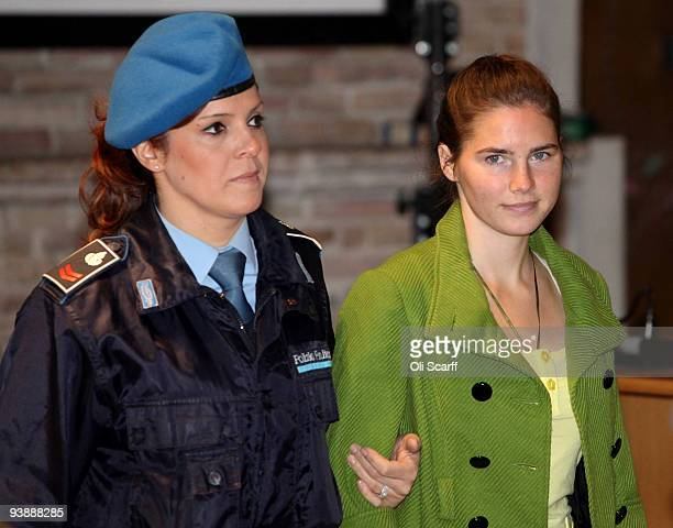 Defendant Amanda Knox is escorted into court for the final day of the Meredith Kercher trial on December 4, 2009 in Perugia, Italy. Amanda Knox and...