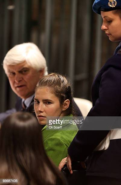 Defendant Amanda Knox speaks to her legal team during the Meredith Kercher trial's closing arguments on December 3 2009 in Perugia Italy Amanda Knox...