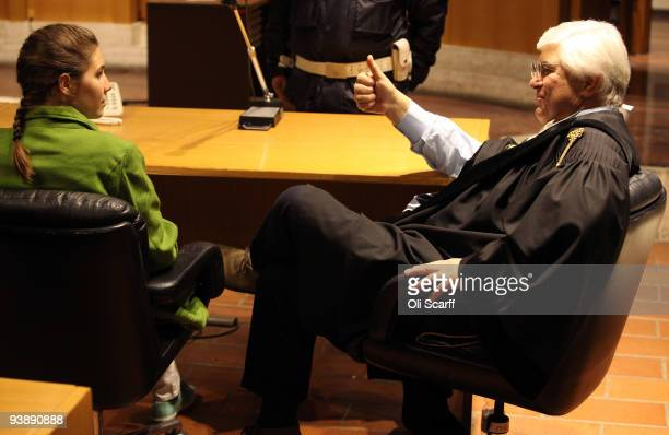 Defendant Amanda Knox takes a seat next to her lawyer Luciano Ghirga on the final day of the Meredith Kercher murder trial on December 4 2009 in...