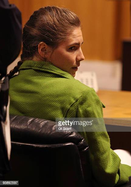 Defendant Amanda Knox takes a seat next to her lawyer on the final day of the Meredith Kercher murder trial on December 4 2009 in Perugia Italy...