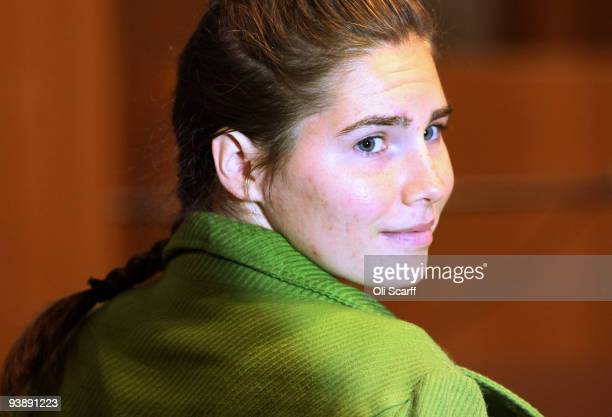 Defendant Amanda Knox takes a seat next to her lawyers on the final day of the Meredith Kercher murder trial on December 4 2009 in Perugia Italy...