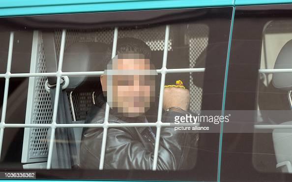 A defendant arrives in a prisoner transport car at the
