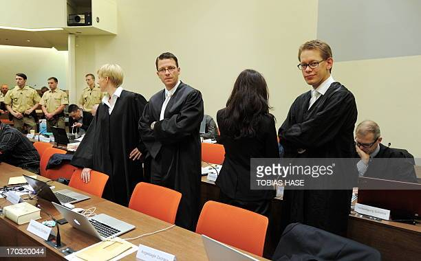 Defendant Beate Zschaepe stands between her lawyers Wolfgang Heer Wolfgang Stahl and Anja Sturm as she waits for the beginning of another session of...