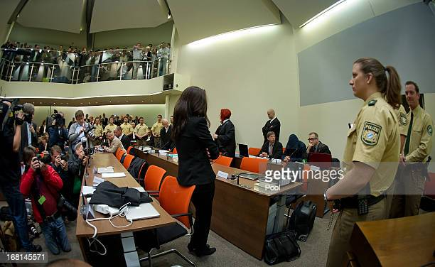 Defendant Beate Zschaepe stands in court on the first day of the NSU neoNazi murder trial on May 6 2013 in Munich Germany The main defendant Beate...