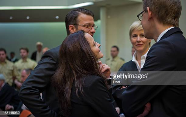 Defendant Beate Zschaepe stands in court with her legal team lawyers Wolfgang Heer Anja Sturm and Wolfgang Stahl on the first day of the NSU neoNazi...