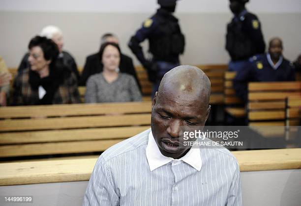Defendant Chris Mahlungu sits in the dock on May 22 2012 ahead of the verdict in the murder trial of white supremacist Afrikaner Resistance Movement...