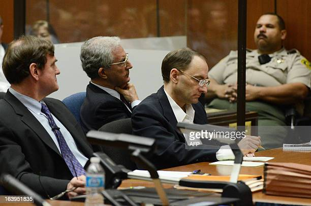 Defendant Christian Gerhartsreiter from Germany sits with his attorneys Jefferey Denner and Brad Bailey as they listen to prosecutor during his...