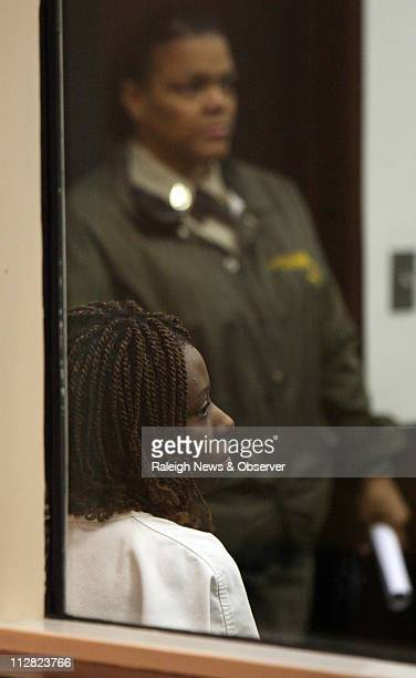 Defendant Crystal Gail Mangum foreground sits in the Durham County jail courtroom Thursday February 18 during a first appearance on multiple felony...