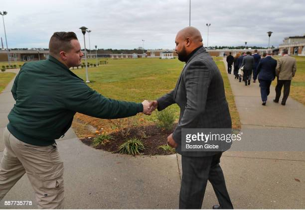 Defendant Derek Howard right shakes hands with a guard at the Bridgewater State Hospital in Bridgewater MA on Dec 6 2017 as a visit to the facility...