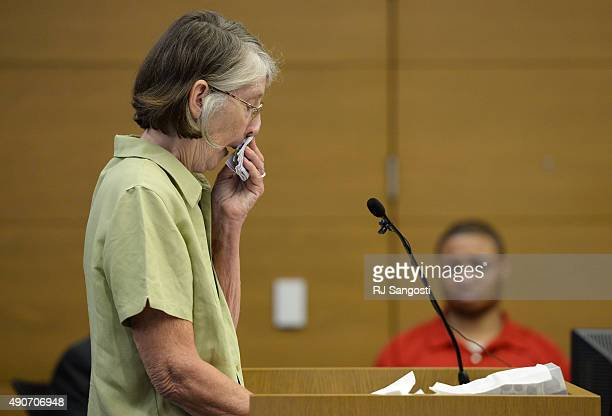 Defendant Dexter Lewis right listens to Kay Richter who's youngest son Ross Richter was murdered speak in court during his sentencing hearing in...