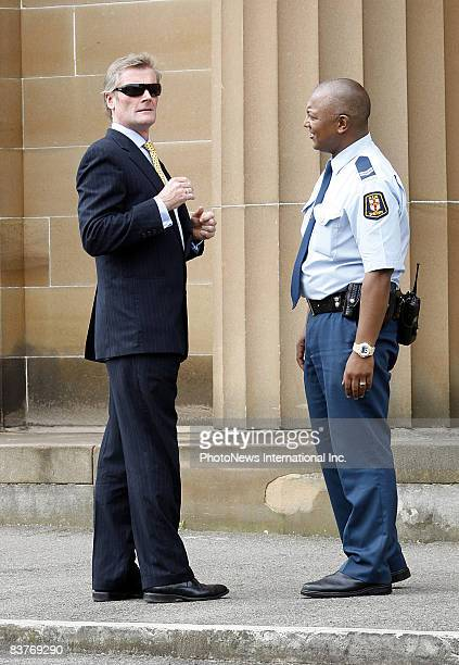 Defendant Gordon Wood chats with a Sheriff's Officer and at one point he tried on the officer's sunglasses at Darlinghurst Court on October 28, 2008...