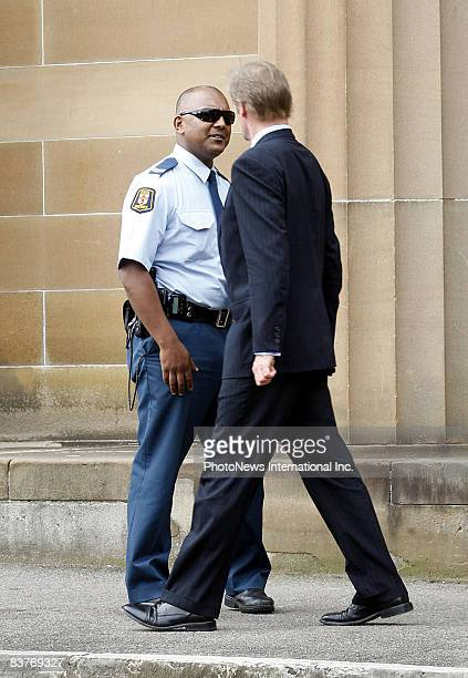 Defendant Gordon Wood chats with a Sheriff's Officer and at one point he tried on the officer's sunglasses at Darlinghurst Court on October 28 2008...