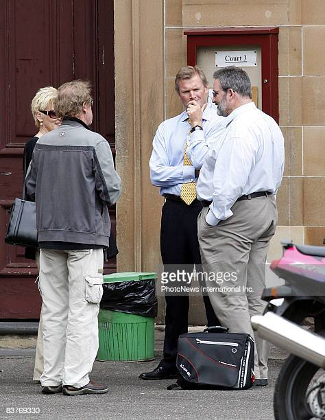 Defendant Gordon Wood talks with friends and family at Darlinghurst Court on October 28 2008 in Sydney Australia Wood was accused of the murder of...