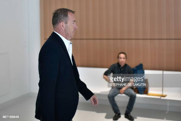 Defendant Jean-Marc Conrad, former Nimes Olympique football club president, arrives at Paris' courthouse on June 4, 2018 for his trial along with...