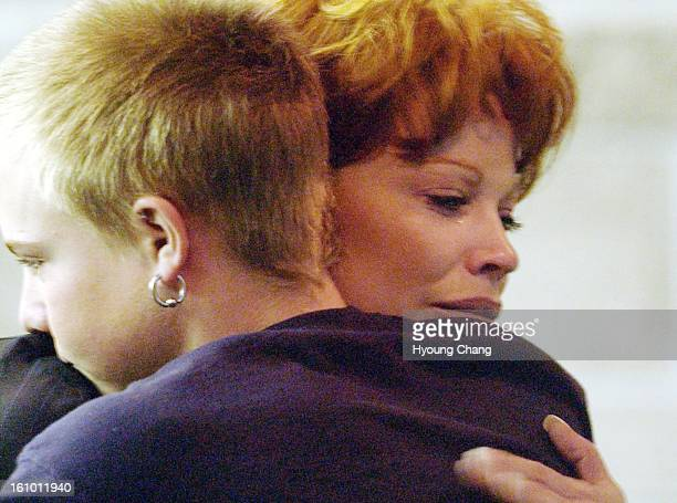 Defendant Koleen Brooks right hugs her nephew Keith Morrell after her finishing the testimony for the false reporting and evidence tampering trial of...