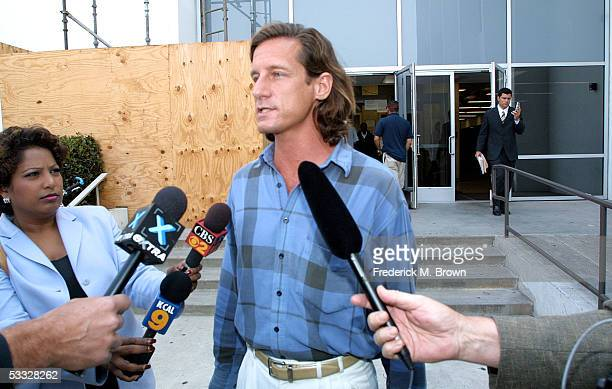 Defendant Matthew Hooker talks to the press after leaving the Santa Monica Couthouse where he appeared on stalking charges for pursuing actress...