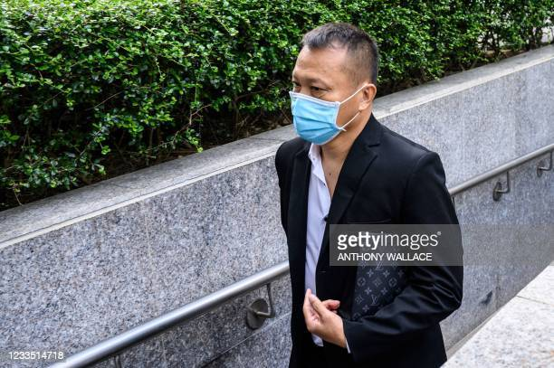 Defendant Tang Ying Bun, one of eight men accused of attacking pro-democracy protesters in Yuen Long in 2019, arrives outside the District Court in...