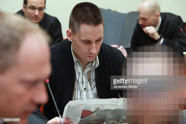 Defendant Ralf Wohlleben reads newspaper in the courtroom on day three of the NSU neoNazis murder trial at the Oberlandgericht Muenchen court on May...