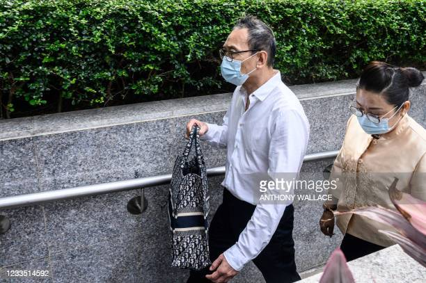 Defendant Tang Wai Sum , one of eight men accused of attacking pro-democracy protesters in Yuen Long in 2019, arrives outside the District Court in...