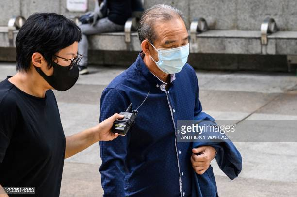 Defendant Tang Ying-Bun , one of eight men accused of attacking pro-democracy protesters in Yuen Long in 2019, arrives outside the District Court in...