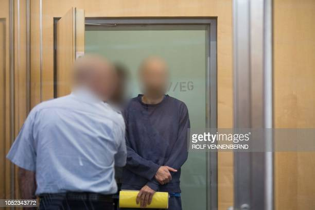 Defendant Thomas K arrives for the beginning of his trial at the Hihgher Regional court in Duesseldorf on October 17 2018 The German Thomas K who was...