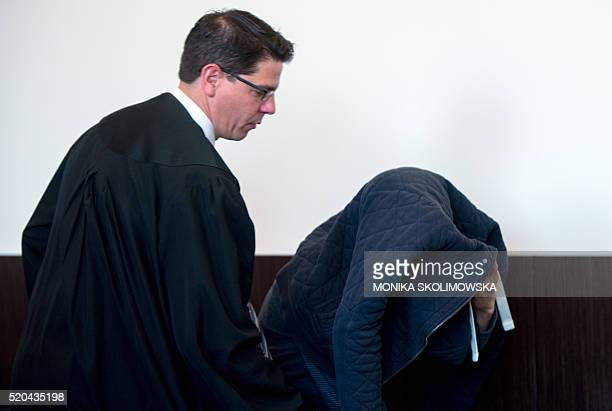 Defendant Tufik M arrives with his lawyer Markus Wittke at the court in Duesseldorf western germany on April 11 2016 Germany put on trial the...