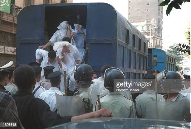 Defendants accused by Egypt''s state security of participating in immoral acts hide their faces as they are escorted by police to a state security...