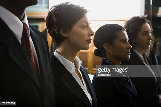 defendants and lawyers in courtroom - verteidiger jurist stock-fotos und bilder
