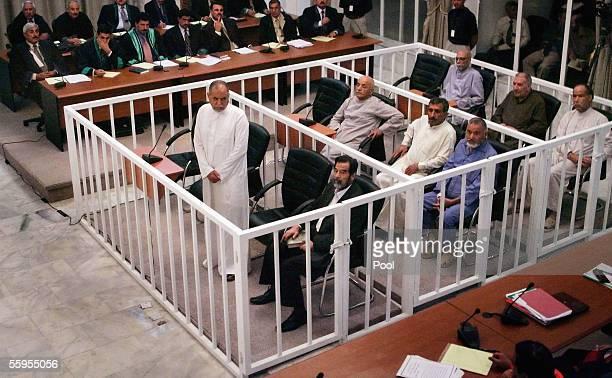 Defendants appear in cages Awad Hamed AlBandar Saddam Hussein Abdullah Kazim Ruwayyid Mizhar Abdullah Ruwayyid Taha Yassin Ramadan Barazan Ibrahim...