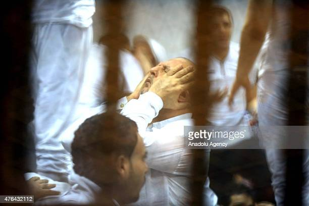 Defendants are seen behind the bars during the trial of Port Said case in Cairo Egypt on June 9 2015 An Egyptian court on Tuesday sentenced 11 people...
